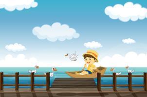 Ein Junge beim Bootfahren vektor