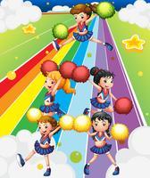 En cheering squad på den färgstarka gatan