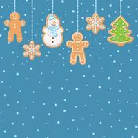 Hängande pepparkaka, träd, snögubbe och stjärnor kakor isolerade på blått