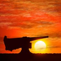 Silhuett av pistol, symboliserar kriget.