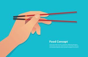 hand som håller ätpinnar vektor