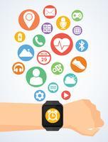 Hand med smartwatch och applikationsikoner på smartwatch