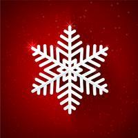 Schneeflocke mit dem Funkeln über dunkelrotem Hintergrund 001
