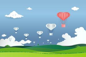 Papierkunst mit Origamipapier Heißluftballonfliegen auf Himmel. Geschäftskonzept der Führung und der Teamarbeit
