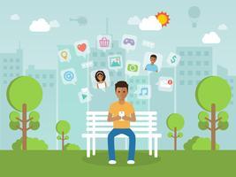 Ung man chattar online på sociala nätverk med smartphone.