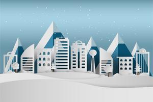 God Jul och Gott Nytt År. Vinterlovssnö i parken vid stadsbilden, papperskonst och hantverksstil.