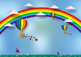 Papierschnitt-Herzform mit Regenbogen und Ballonen für LGBT- oder GLBT-Stolz oder Lesbe, Homosexuell, Bisexuell, Transgender, auf blauem Hintergrund