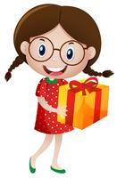 Liten tjej med presentförpackning