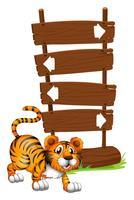 Tiger vor einem hölzernen Schild vektor