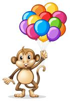 Söt apa med färgstarka ballonger