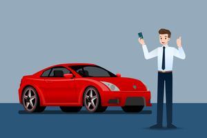 Glad affärsman, säljare står och innehar kreditkort framför lyxbil som parkerar i stort showroom.