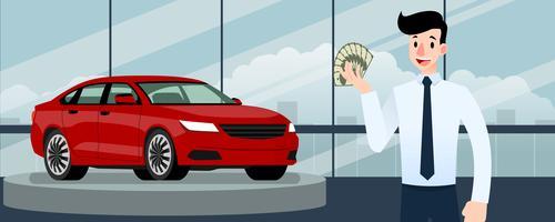 Glad affärsman, säljare står och håller pengar framför lyxbil som parkerar i stort showroom i staden.