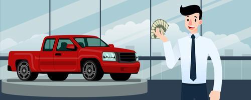 Glad affärsman, säljare står och innehar kreditkort framför röda pickup truck som parkerar i stort showroom i staden.