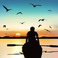 Schattenbild eines Kayak fahrenden Mannes.