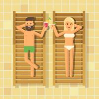 Man och kvinna dricker cocktails i schäslonger vid poolen
