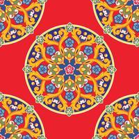 Sömlös mönster bakgrund. Färgrik etnisk rund prydnadsmandala på röd. Vektor illustration