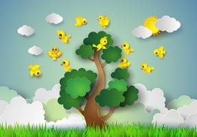 Vogel fliegt um einen Baum.