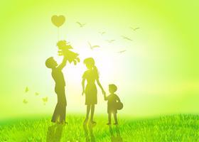 glad familj vid soluppgången.