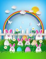 Ostern-Hintergrund mit Eiern und Kaninchen im Gras mit Regenbogen