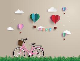 Rosafarbene Fahrräder geparkt auf dem Gras