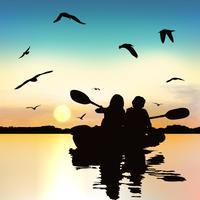 Schattenbild von den lustigen Kayak fahrenden Mädchen.