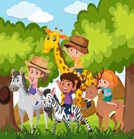 Barn som rider djur i vilda djur