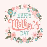Lycklig mors dag hand bokstäver med blomma krans vektor kalligrafi bokstäver