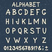 Handgjord typsnitt. Handskriven alfabet. Ursprungliga bokstäver och siffror. Tappning retro handtecknad typsnitt med grunge bakgrund.