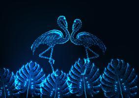 Tropisches Sommerkonzept mit glühenden niedrigen Polypaaren von Flamingos und von Monstera verlässt auf dunkelblauem.