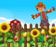 Scarecrow på solrosfältet vektor