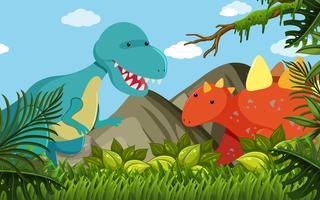 Två dinosaurier i fältet