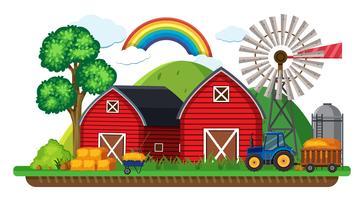 Gårdsplats med traktor och hö