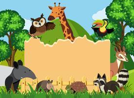 Grenzschablone mit wilden Tieren im Park vektor