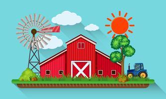 Stor röd ladugård och blå traktor
