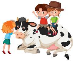 Kinder und Kuh auf weißem Hintergrund vektor