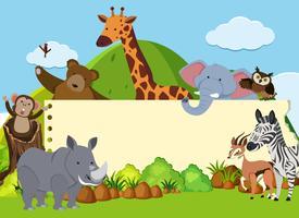 Grenzschablone mit wilden Tieren auf dem Gebiet vektor