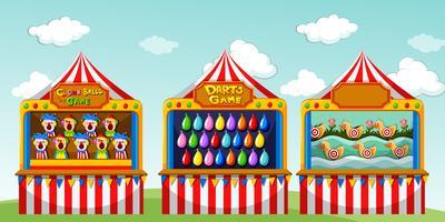Tre spel boothes på cirkusen
