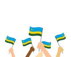 Vector Illustration von den Händen, die Ruanda-Flaggen lokalisiert auf weißem Hintergrund halten
