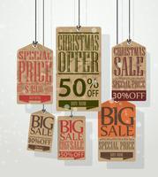 Julförsäljning taggar. Vintage stil taggar och etiketter vektor