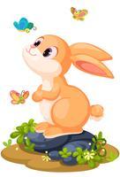 Nettes Kaninchen, das mit Schmetterlingen spielt