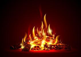 Schwelendes Lagerfeuer nachts mit roten Kohlen