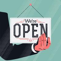 Hand med Vi är öppna tecken