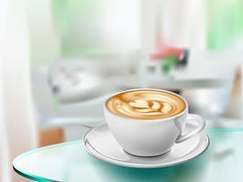 Kopp kaffe på glasbord i ljust rum