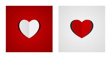 Vikta och snittade hjärtformer på röda och vita bakgrunder