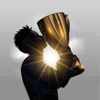 Fotbollsspelare kyssande trofé