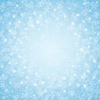 Julen i centrum blå himmel snöflingor mönster bakgrund.