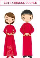 söta kinesiska par i röd traditionell klänning seriefigur vektor