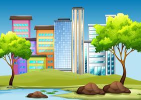 Gebäude und Park in der Stadt vektor
