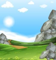 Naturszene mit Feld und Steinen