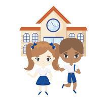 söta små elever framför skolan